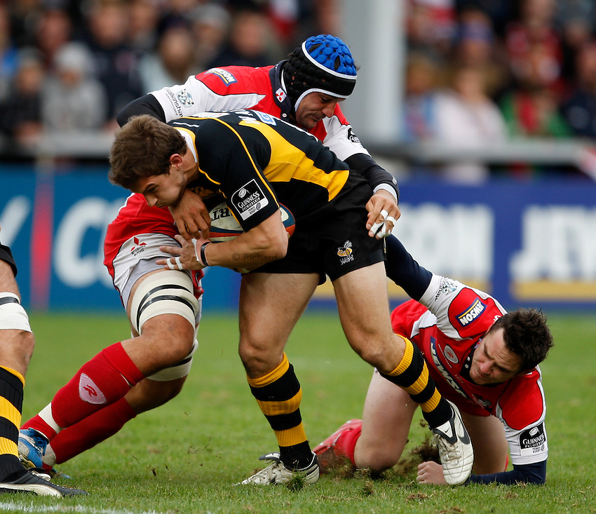 Photo: Richard Lane/Richard Lane Photography. Gloucester Rugby v London Wasps. Anglo Welsh EDF Energy Cup. 04/10/2008. Wasps' Dominic Waldouck is tackled by the Goucester defence.