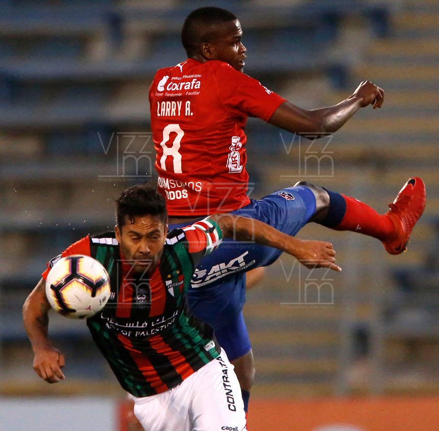 SANTIAGO DE CHILE - CHILE: 06-02-2019: José Luis Jimenez de Club Deportivo Palestino  (CHL) disputa el balón con Larry Angulo de Deportivo Independiente Medellín (COL), durante partido de la Segunda fase, llave 4, entre Club Deportivo Palestino (CHL) y Deportivo Independiente Medellín (COL), por la Copa Conmebol Libertadores 2019 en el estadio San Carlos de Apoquindio, de la ciudad de Santiago de Chile. / José Luis Jimenez of Club Deportivo Palestino (CHL), vies for the ball with Larry Angulo Deportivo Independiente Medellin (COL), during a match between Club Deportivo Palestino  (CHL) and Deportivo Independiente Medellin of the second phase, key 4, for Copa Conmebol Libertadores 2019 at the San Carlos de Apoquindio, Stadium, in the city of Santiago de Chile. Photos: VizzorImage / Andrés Piña / Cont. / Photosport