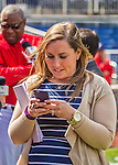 7 April 2016: Washington Nationals Senior Director of Communications Amanda Comak communicates prior to their Home Opening Game against the Miami Marlins at Nationals Park in Washington, DC. The Marlins defeated the Nationals 6-4 in their first meeting of the 2016 MLB season. Mandatory Credit: Ed Wolfstein Photo *** RAW (NEF) Image File Available ***
