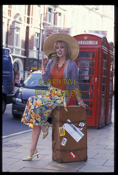JOANNA LUMLEY .31 May 2000.Ref: 9699.sitting, leaning, full length, full-length, hat.*RAW SCAN- photo will be adjusted for publication*.www.capitalpictures.com.sales@capitalpictures.com.©Capital Pictures