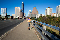 The best place to run in Austin is on the Congress Avenue Bridge along the Lady Bird Lake Trail. The Congress Avenue Bridge is home to many national marathon and 10K races - Stock Image.