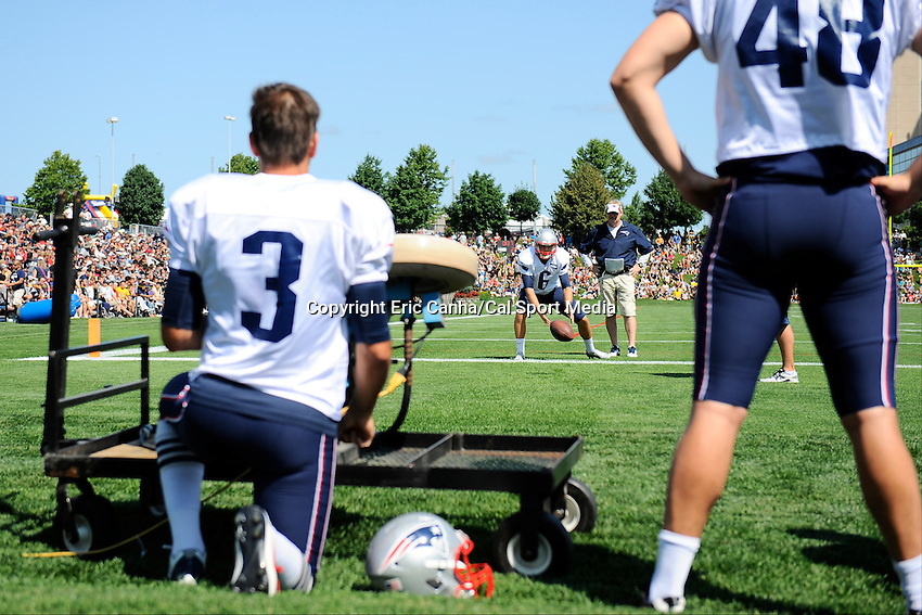 July 29, 2014 - Foxborough, Massachusetts, U.S.- New England Patriots kicker Stephen Gostkowski (3) and punter Ryan Allen (6) work on low snaps under the watch of special teams coach Scott O'Brien during the New England Patriots training camp held at Gillette Stadium in Foxborough Massachusetts.  Eric Canha/CSM