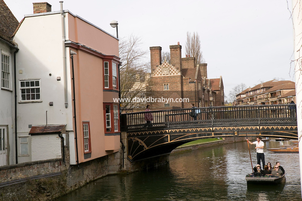 A punt navigates down the River Cam past Magdalene College buildings in Cambridge, United Kingdom, 12 March 2007.