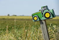 USA, Iowa, Soy bean field and John Deere tractor letterbox of farmer