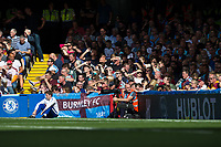 Burnley fans shield themselves from the sun in the second half<br /> <br /> Photographer Craig Mercer/CameraSport<br /> <br /> The Premier League - Chelsea v Burnley - Saturday August 12th 2017 - Stamford Bridge - London<br /> <br /> World Copyright &copy; 2017 CameraSport. All rights reserved. 43 Linden Ave. Countesthorpe. Leicester. England. LE8 5PG - Tel: +44 (0) 116 277 4147 - admin@camerasport.com - www.camerasport.com
