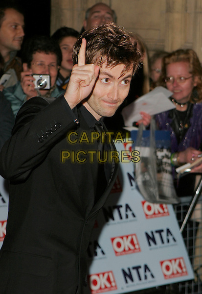 DAVID TENNANT.Arrivals at the 12th Annual National Television Awards 2006, held at the Royal Albert Hall, London, England, October 31st 2006..half length hand fingers funny gesture.CAP/AH.©Adam Houghton/Capital Pictures.