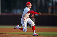 Belmont Abbey Crusaders starting pitcher Cameron Busby (9) follows through on his delivery against the against the Catawba Indians at Abbey Yard on February 7, 2017 in Belmont, North Carolina.  The Crusaders defeated the Indians 12-9.  (Brian Westerholt/Four Seam Images)