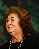 Washington, DC - October 30, 2009 -- Jeanne White-Ginder, mother of Ryan White, listens as United States President Barack Obama makes remarks prior to signing the Ryan White HIV/AIDS treatment extension act of 2009 in the Diplomatic Room of the White House, Washington, DC, Friday, October 30, 2009. The act is the largest federally funded program for people living with HIV/AIDS in the US, and was named in honor of Ryan White, a  teenager  who contracted AIDS  through a tainted hemophilia treatment in 1984  and  became a well-known advocate for AIDS research  and awareness, until his death on April 8, 1990..Credit: Aude Guerrucci / Pool via CNP