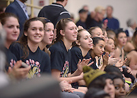 NWA Democrat-Gazette/BEN GOFF @NWABENGOFF<br /> The Bentonville girls basketball team watches on Friday Jan. 15, 2016 during Bentonville High's colors day ceremony at halftime in the boys basketball game against Springdale Har-Ber in Bentonville's Tiger Arena.