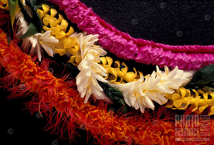 Three Hawaiian leis; ohai alii, puakenikeni & ti leaf & white ginger, and maunaloa orchid