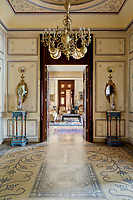 The opulent 19th century apartment  exudes sensuality, fantasy and passion. At the entrance, marble mosaic paving and patina-finished walls. The chandelier by Ferdinand Barbedienne dates back to the 19th century.