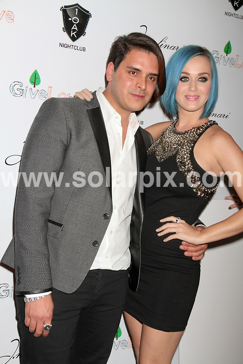 **ALL ROUND PICTURES FROM SOLARPIX.COM**                                             **SYNDICATION RIGHTS FOR UK, AUSTRALIA, DENMARK, PORTUGAL, S. AFRICA, SPAIN & DUBAI (U.A.E) & ASIA (EXCLUDING JAPAN) ONLY**                                                                                   Arrivals for the 1OAK Nightclub Opening Weekend and GiveLove Event with Co Hosts Katy Perry and J. Molinari Jewelry  at the Mirage Hotel and Casino in Las Vegas, NV, USA.                                                                        .This pic:   Katy Perry & Markus Molinari                                                                                      JOB REF:   14396   PHZ Paludipan   DATE:   27.01.12                                                         **MUST CREDIT SOLARPIX.COM OR DOUBLE FEE WILL BE CHARGED**                                                                      **MUST AGREE FEE BEFORE ONLINE USAGE**                               **CALL US ON: +34 952 811 768 or LOW RATE FROM UK 0844 617 7637**