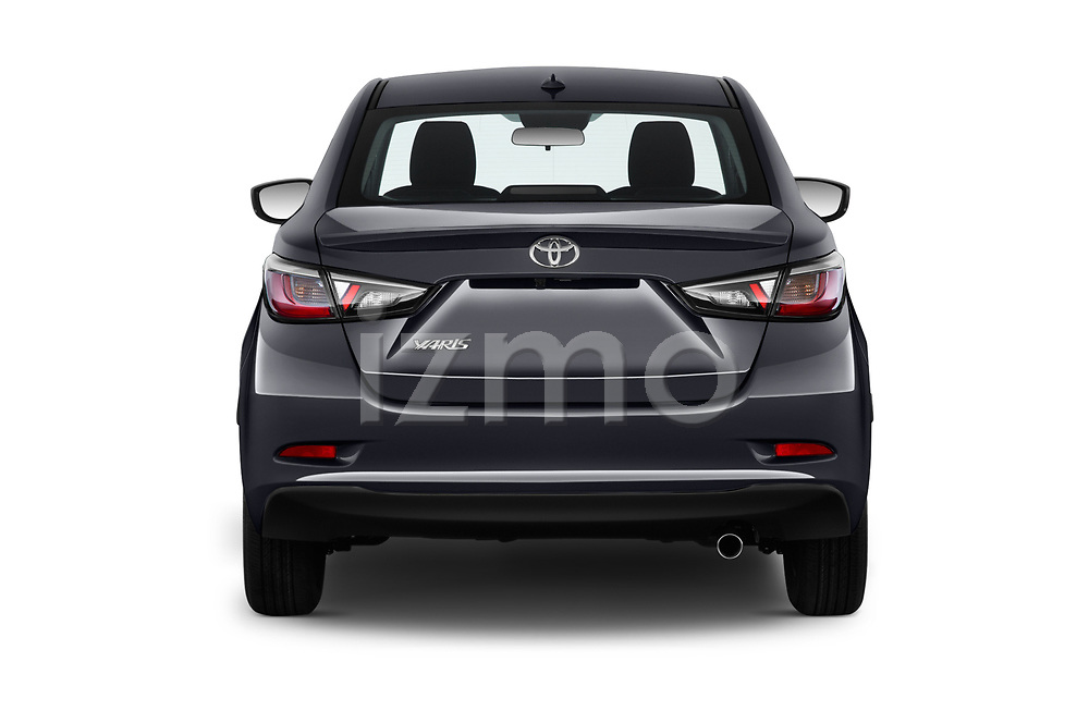 Straight rear view of a 2018 Toyota Yaris LE 4 Door Sedan stock images