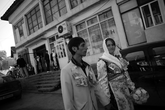 Djamal and Fatme are walking down the central street during the celebration of the wedding ceremony in the village of Ribnovo, some 200 km from Sofia, Bulgaria.