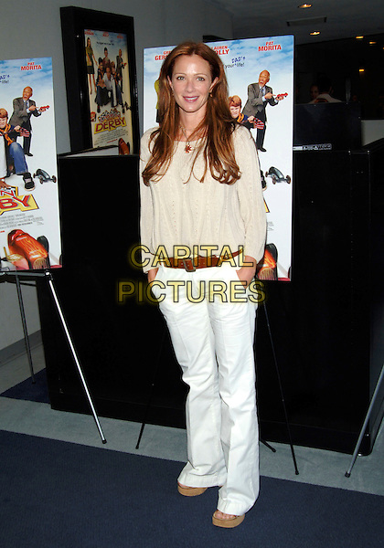"LAUREN HOLLY.""Down And Derby"" Premiere held at the Harmony Gold Theatre. .Photo Credit: Jacqui Wong/AdMedia.April 9th, 2005.full length white summery light trousers hands in pockets beige top brown belt.www.capitalpictures.com.sales@capitalpictures.com.© Capital Pictures."