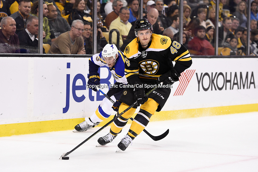 Tuesday, December 22, 2015: St. Louis Blues right wing Dmitrij Jaskin (23) tries to stop Boston Bruins defenseman Colin Miller (48) as he works the puck through the corner during the National Hockey League game between the St. Louis Blues and the Boston Bruins held at TD Garden, in Boston, Massachusetts. The blues beat the Bruins 2-0 in regulation time. Eric Canha/CSM