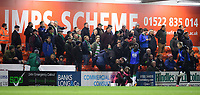 Yeovil Town fans watch their team in action<br /> <br /> Photographer Chris Vaughan/CameraSport<br /> <br /> The EFL Sky Bet League Two - Lincoln City v Yeovil Town - Friday 8th March 2019 - Sincil Bank - Lincoln<br /> <br /> World Copyright © 2019 CameraSport. All rights reserved. 43 Linden Ave. Countesthorpe. Leicester. England. LE8 5PG - Tel: +44 (0) 116 277 4147 - admin@camerasport.com - www.camerasport.com