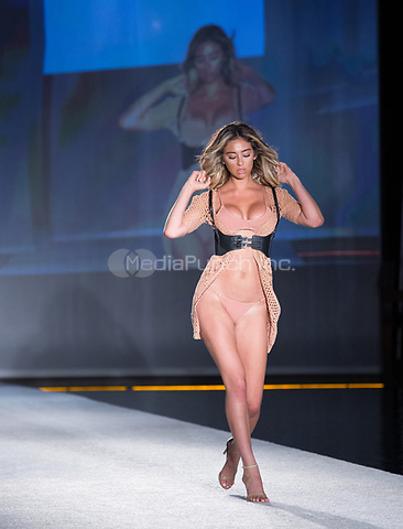MIAMI BEACH, FL - JULY 23: A model walks the runway during the SWIMMIAMI Baes and Bikinis 2018 fashion show at WET Deck at the W South Beach in Miami Beach. July 23, 2017. Credit Aaron Gilbert/MediaPunch