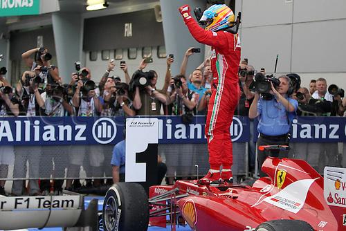 25.03.2012. Kuala Lumpur Malaysia.   FIA Formula One World Championship 2012 Grand Prix of Malaysia 5 Fernando Alonso ESP Scuderia Ferrari jumps from his car in celebration