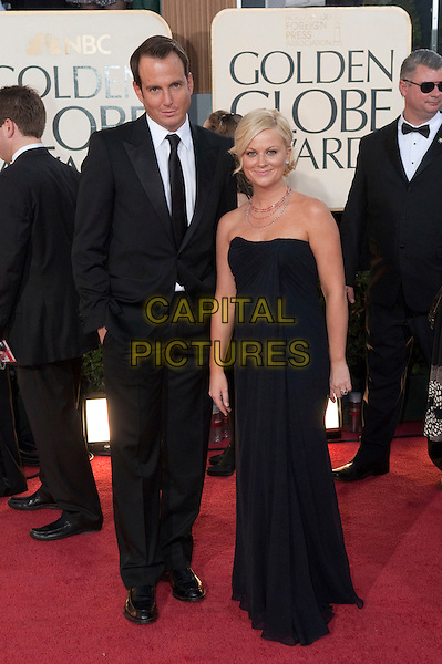 WILL ARNETT & AMY POEHLER.Arrivals at the 66th Annual Golden Globe Awards held at the Beverly Hilton Hotel, Beverly Hills, California, USA..January 11th, 2009.*Editorial Use Only* .globes full length black suit married husband wife strapless dress .CAP/AWF/HFPA .Supplied by Capital Pictures.