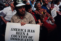 (970522-SWR09)--File Photo -- New York, NY -- Thousands of immigrants who gathered in Battery Park, in the shadow of the Statue of Liberty and Ellis Island, for a Rally for Immigrants Rights.  Photo © Stacy Walsh Rosenstock