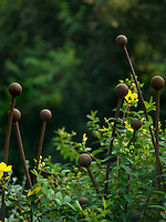 Close-up detail of the allium-shaped metal fence