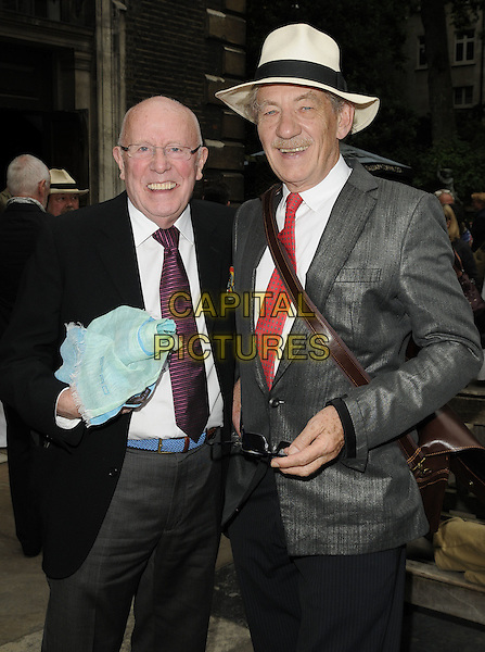 Richard Wilson & Sir Ian McKellen.Pam Gems Memorial Service, St. James' Church, Piccadilly, London, England..July 3rd, 2011.half length grey gray suit jacket white hat fedora glasses red tie moustache mustache facial hair smiling black trousers.CAP/CAN.©Can Nguyen/Capital Pictures.