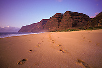 Late afternoon stroll on Polihale Beach, Hawaiis longest beach, at Polihale State Park, end of the road on west Kaua`i.