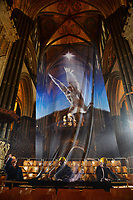 BNPS.co.uk (01202 558833)<br /> Pic: ZacharyCulpin/BNPS<br /> <br /> Pictured: Falling angel -  workers put the finishing touches to the nativity.<br /> <br /> One of the UK's most historic cathedrals today unveiled a 40ft Renaissance-style photographic tableau as its nativity - with its very own clergy, volunteers and staff starring as figures from the Christian scene.<br /> <br /> Salisbury Cathedral's spectacular nativity features its stonemason as Joseph, a bookings agent as Mary, a retired postman as a shepherd, a Canon and guides as Wise Men - and the son of an ex-England rugby player as baby Jesus.<br /> <br /> The Wiltshire cathedral wanted to put a modern twist on the traditional Christmas scene and cast people as Nativity characters before holding a series of individual and group photoshoots.