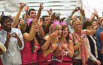 031409tvgocrazy.Fans waiting for hours to catch a glimpse of Paris Hilton go crazy after she made her appearance at Macy's.  In the center, in matching pink shirts, are L to R: Laura Biriones, Lana Albert and Andrea Morlan who came from Centralia to see Hilton..BND/TIM VIZER