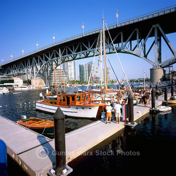 Vancouver, BC, British Columbia, Canada - Historic Wooden Boats docked in False Creek at Granville Island, under Granville Street Bridge
