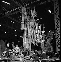 Sections of frameworks for a B-17F (Flying Fortress) bomber fuselages at the Boeing plant in Seattle. 1942.<br /> <br /> Photo by Andreas Feininger.