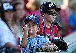 An unidentified fan reacts to Harley Davidson motorcycles rumbling across the field during the pre-game ceremonies of the Triple-A All Star Home Run Derby in Reno, Nev., on Monday, July 15, 2013. <br /> Photo by Cathleen Allison