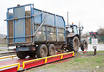Tractor and trailer on a weighbridge weighing its load, UK