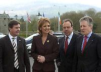 DUP IN KILLARNEY 25-4-06<br /> With the Union Jack and The Tricolour in the background members of the DUP led by Peter Robinson, right, Jeffrey Donaldon, Irish Robinson and Nigel Dobbs arrive at the Brehon Hotel, Killarney for the  the 32nd plenary conference  of the British-Irish Inter Parliamentary Body on Monday.<br /> Picture by Don MacMonagle