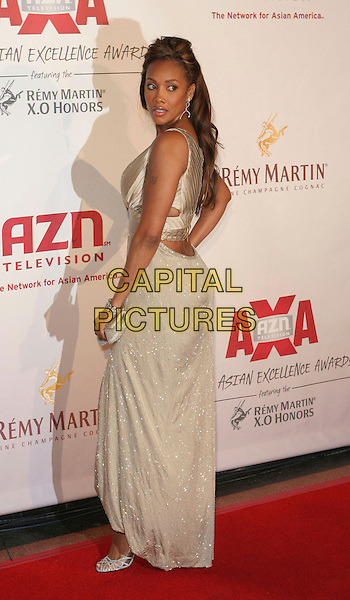 VIVICA A. FOX.The 2006 Asian Excellence Awards, Los Angeles, California..January 19th, 2006.Photo: Zach Lipp/AdMedia/Capital Pictures.Ref: ZL/ADM.full length beige dress looking over shoulder.www.capitalpictures.com.sales@capitalpictures.com.© Capital Pictures.