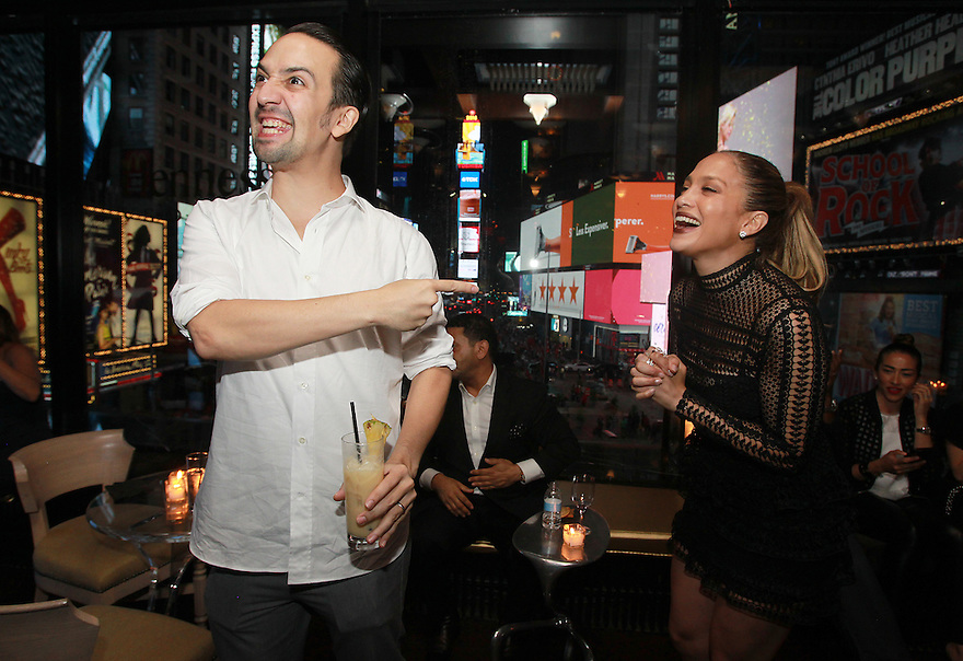 "Actor Lin-Manuel Miranda left, is seen enjoying his Hennessy V.S.O.P Privilege Lin-Manuel Miranda drink, while sharing a moment with Singer Jennifer Lopez right, at the R Lounge where Hennessy V.S.O.P Privilege Celebrated Lin-Manuel Miranda's Final Performance in ""Hamilton""  on Saturday, July 9, 2016, in New York. (Photo by Donald Traill/Invision for Hennessy V.S.O.P Privilege/AP Images)"