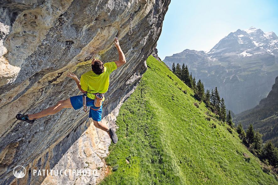 Sport climbing at the tremendously hard and steep limestone crag at Gimmelwald, Switzerland, above the Lauterbrunnen Valley