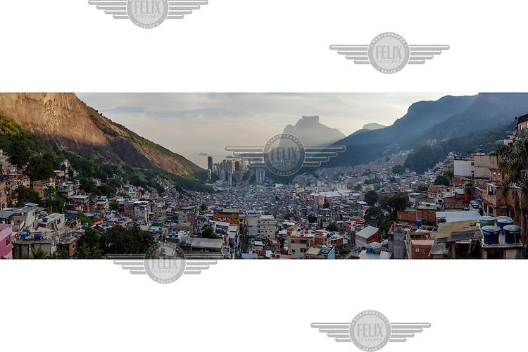 A view from the Rocinha favela towards the high rise buildings of Sao Conrado and the unusally shaped summit of Pedra da Gavea.