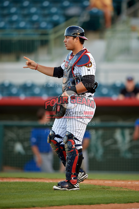 Florida Fire Frogs catcher Alex Jackson (25) signals to the defense during a game against the Dunedin Blue Jays on April 10, 2017 at Osceola County Stadium in Kissimmee, Florida.  Florida defeated Dunedin 4-0.  (Mike Janes/Four Seam Images)