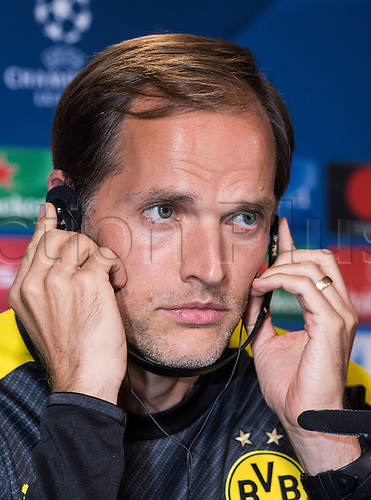 26.09.2016. Dortmund, Germany.  Coach Thomas Tuchel from Borussia Dortmund listens to questions in Spanish through headphones during a press conference in Dortmund, Germany, 26 September 2016. Dortmund plays in Champions League versus Real Madrid on 27 September 2016.