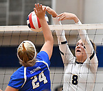 Columbia's Lindsay Wibbenmeyer (left) defends as Althoff's Karinna Gall hits the ball over the net. Althoff defeated Columbia in two games in volleyball action on Thursday August 23, 2018.<br /> Tim Vizer/Special to STLhighschoolsports.com