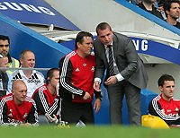 Pictured: Swansea manager Brendan Rodgers (R) with coach Colin Pascoe (L). Saturday 17 September 2011<br /> Re: Premiership football Chelsea FC v Swansea City FC at the Stamford Bridge Stadium, London.