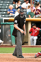Umpire Brandon Henson handles the calls behind the plate during the Pacific Coast League game between the Salt Lake Bees and the El Paso Chihuahuas at Smith's Ballpark on August 7, 2014 in Salt Lake City, Utah.  (Stephen Smith/Four Seam Images)