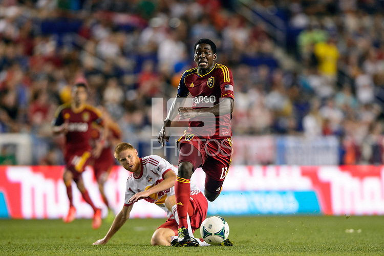 Olmes Garcia (13) of Real Salt Lake gets past Markus Holgersson (5) of the New York Red Bulls. The New York Red Bulls defeated Real Salt Lake 4-3 during a Major League Soccer (MLS) match at Red Bull Arena in Harrison, NJ, on July 27, 2013.