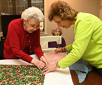 NWA Democrat-Gazette/ANDY SHUPE<br /> Marie Breuer (from left), Cornelia &quot;Neely&quot; Barnett and Libby Dutton work together Wednesday, March 15, 2017, to make sleeping bags for area homeless in the chapel at Butterfield Trail Village in Fayetteville. The group has made approximately 30 bags over the past few years using the &quot;My Brother's Keeper&quot; quilt group model, a national volunteer effort that promotes &quot;The Sleeping Bag Project.&quot;