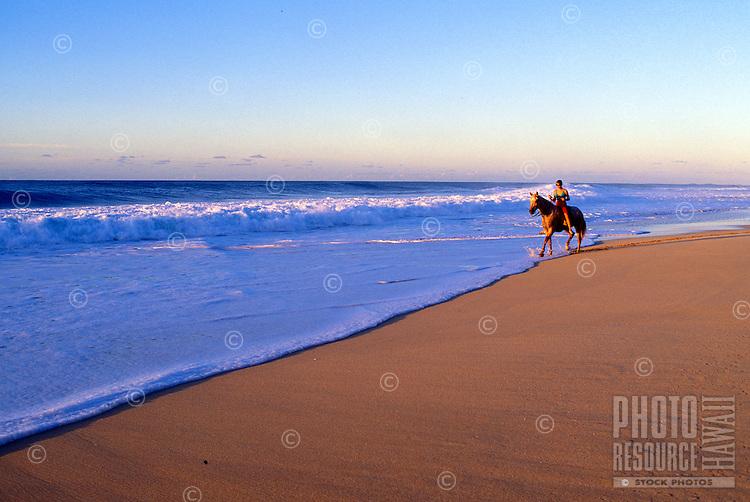 Woman horseback riding along the waters of North Shore Oahu
