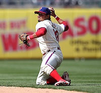 Philadelphia Phillies second baseman Freddy Galvis #13 throws to first during their home opener against the Miami Marlins at Citizens Bank Park on April 9, 2012 in Philadelphia, Pennsylvania.  Miami defeated Philadelphia 6-2.  (Mike Janes/Four Seam Images)