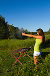 Young women shooting a Springfield 1911 .45 ACP