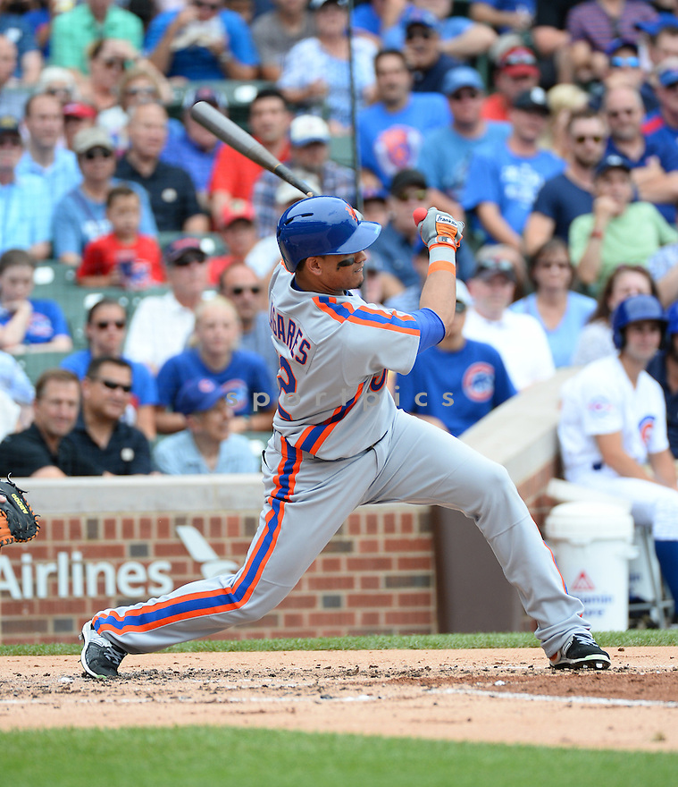 New York Mets Juan LaGares (12) during a game against the Chicago Cubs on July 20, 2016 at Wrigley Field in Chicago, IL. The Cubs beat the Mets 6-2.